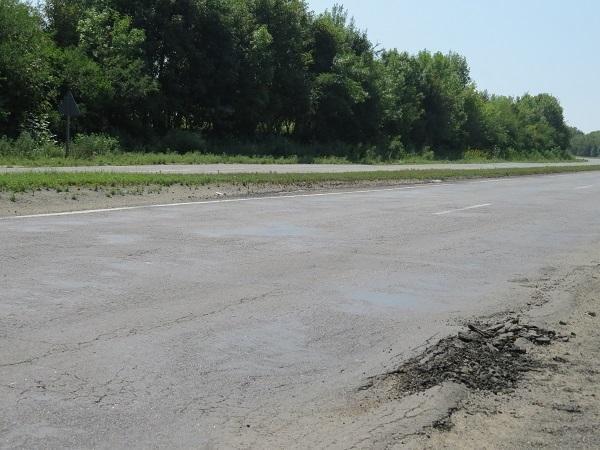 Водії вантажівок свідомо ігнорують заборону, руйнуючи дороги Хмельниччини, фото-4