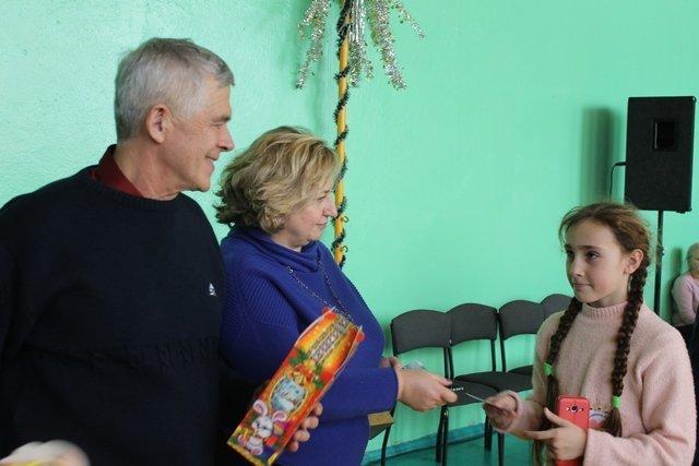 Для діток з особливими потребами та дітей, батьки яких загинули в зоні АТО, влаштували свято з розвагами та подарунками, фото-6